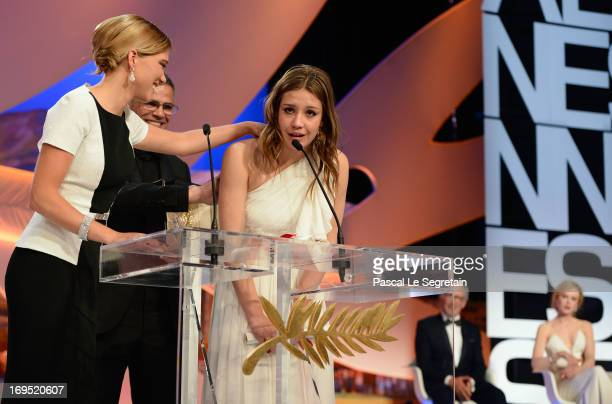 Actress Lea Seydoux director Abdellatif Kechiche and actress Adele Exarchopoulos on stage after 'La Vie D'Adele' receives the 'Palme d'Or' at the...