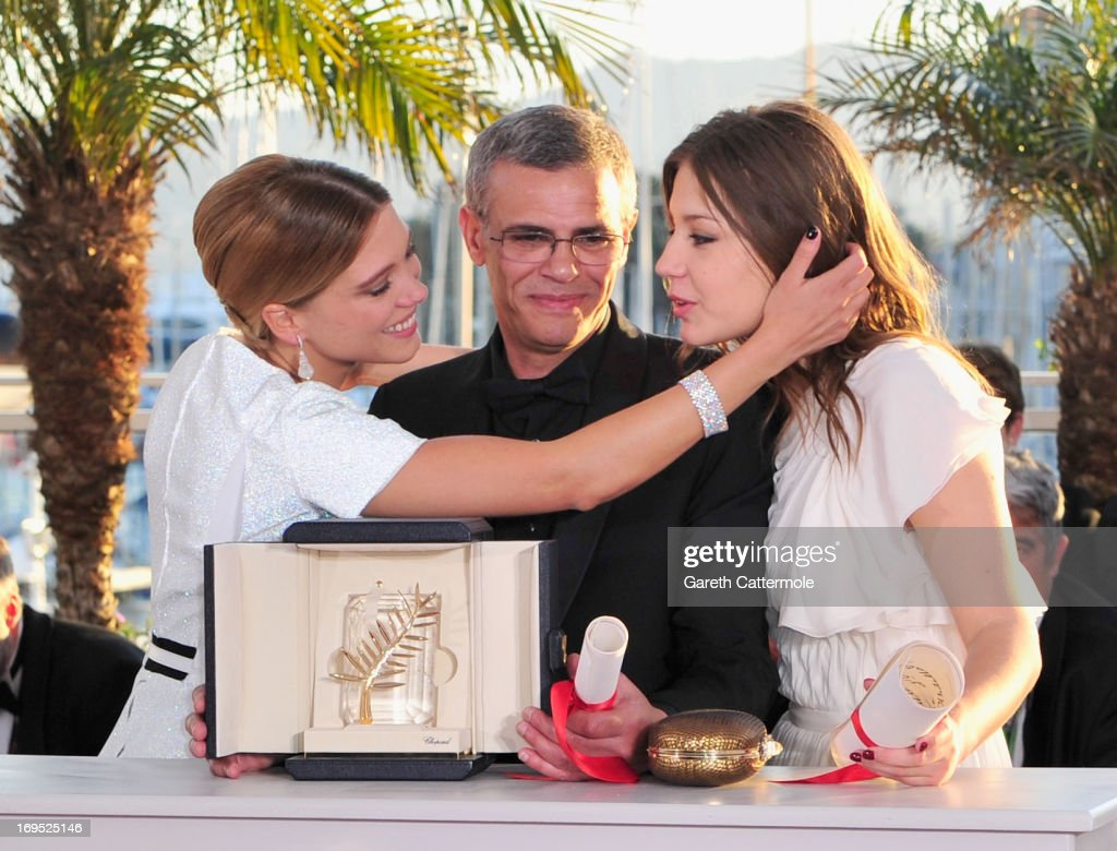 Actress Lea Seydoux, Director Abdellatif Kechiche and Adele Exarchopoulos pose with the 'Palme d'Or' for 'La Vie D'adele' at the Palme D'Or Winners Photocall during the 66th Annual Cannes Film Festival at the Palais des Festivals on May 26, 2013 in Cannes, France.