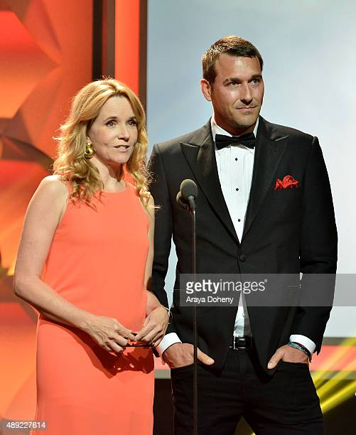 Actress Lea Thompson and TV host Brandon McMillan onstage at the American Humane Association's 5th Annual Hero Dog Awards 2015 at The Beverly Hilton...