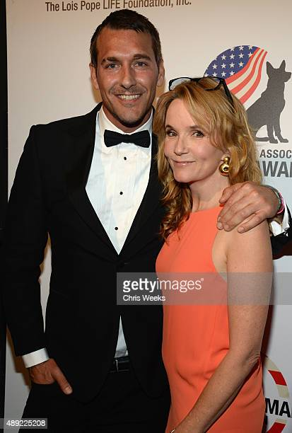 Actress Lea Thompson and TV host Brandon McMillan pose backstage at the American Humane Association's 5th Annual Hero Dog Awards 2015 at The Beverly...