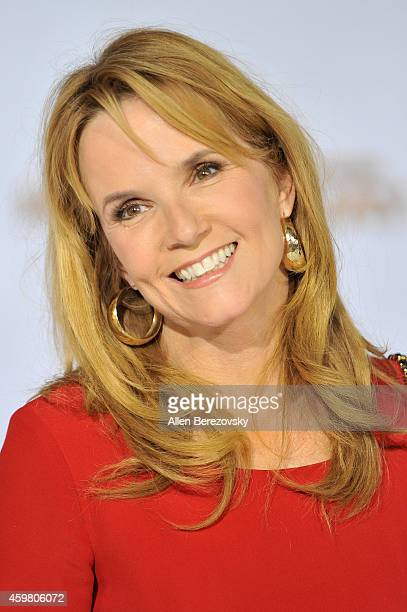 """Actress Lea Thompson arrives at the Los Angeles premiere of """"The Hunger Games: Mockingjay - Part 1"""" at Nokia Theatre L.A. Live on November 17, 2014..."""