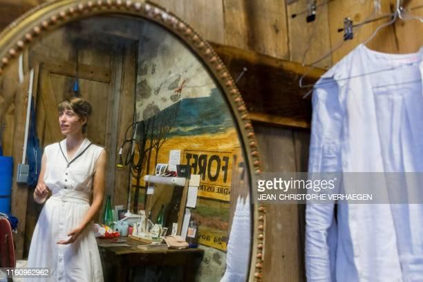 "Actress Lea Tissier stands in front of a mirror in her dressing room during intermission of ""La vie est un reve"" written by Pedro Calderon de la..."