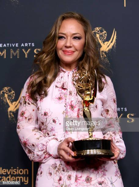 "Actress Leah Remini poses in the press room with the award for outstanding informational series or special for ""Leah Remini: Scientology and the..."