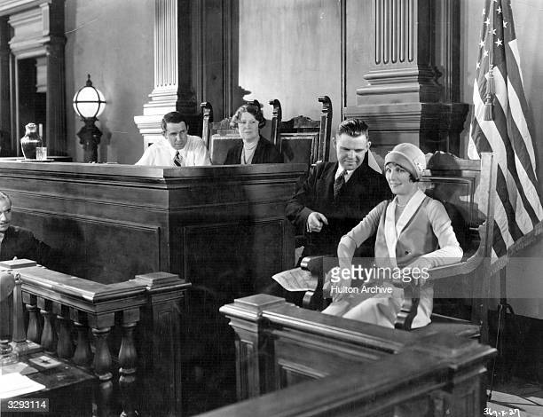 Actress Leatrice Joy , with Samuel Blake, Georgia Bullock and director Monta Bell on the set of the MGM courtroom drama 'The Bellamy Trial'.