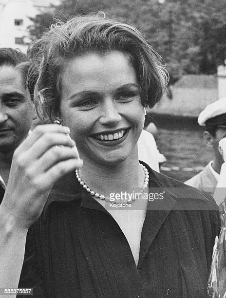 Actress Lee Remick smiling as she gets off a motor boat to attend a showing of her film 'Anatomy of a Murder' at the Venice Film Festival September...