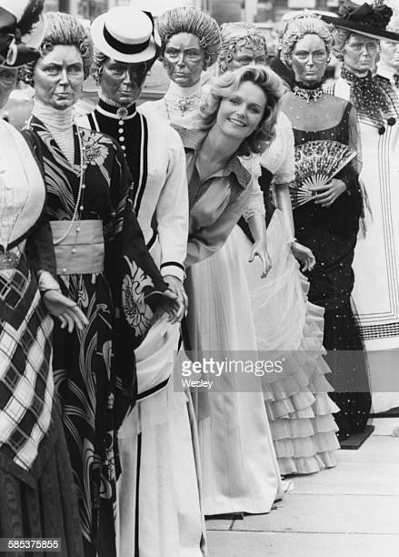 Actress Lee Remick standing in between mannequins wearing some of the costumes she wears in the television show 'Jennie Lady Randolph Churchill' at a...