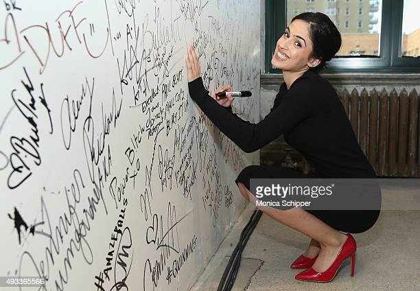 Actress Leem Lubany signs the wall at AOL Studios when she visits for AOL Build Presents Rock The Kasbah at AOL Studios In New York on October 19...