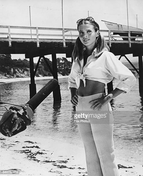 Actress Leigh TaylorYoung standing next to a pier making the film 'The Big Bounce' on the beach at Monterey California December 27th 1968