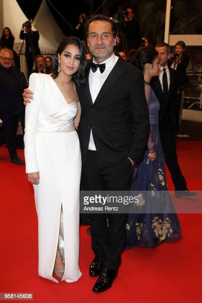 Actress Leila Bekhti and director Gilles Lellouche depart after the screening of 'Sink Or Swim ' during the 71st annual Cannes Film Festival at...