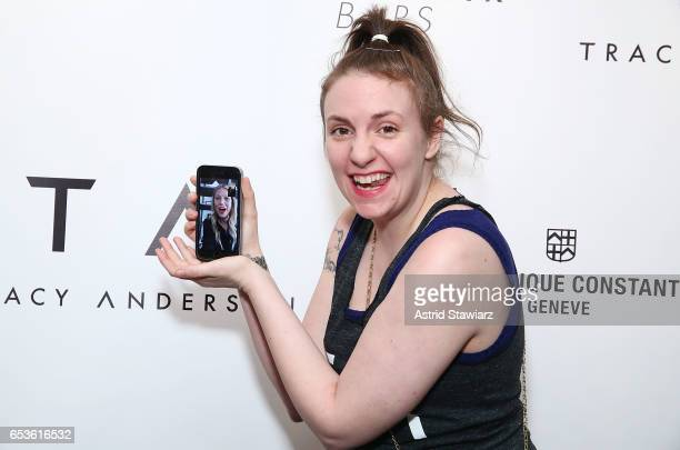 Actress Lena Dunham uses an iphone to facetime actress Gwyneth Paltrow during the celebration of the Tracy Anderson 59th Street studio on March 15,...