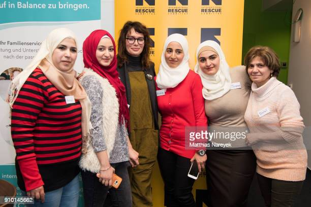 Actress Lena Headey poses for a photo with refugee woman from Syria on January 25 2018 in Berlin Germany The Federal Government Commissioner for...