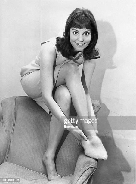 Actress Lesley Ann Warren dons a fur slipper Warren portrays Cinderella in a television production of the tale