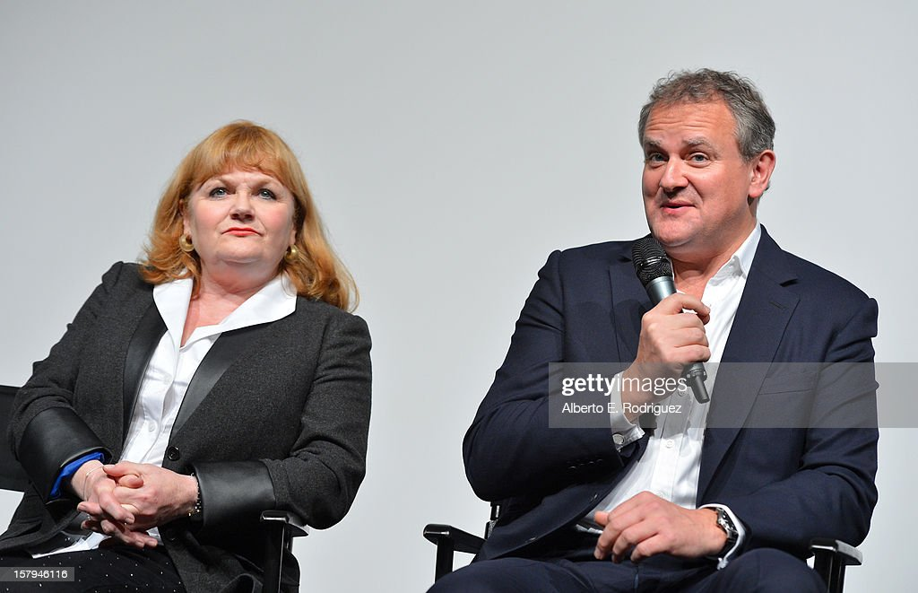 Actress Lesley Nicol looks on as fellow actor and cast member Hugh Bonneville speaks during the Q&A session as part of The Hollywood Reporter screening of PBS Masterpiece's 'Downton Abbey' Season 3 on December 7, 2012 in West Hollywood, California.