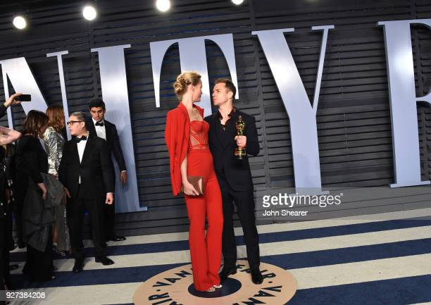 Actress Leslie Bibb and actor Sam Rockwell attend the 2018 Vanity Fair Oscar Party hosted by Radhika Jones at Wallis Annenberg Center for the...