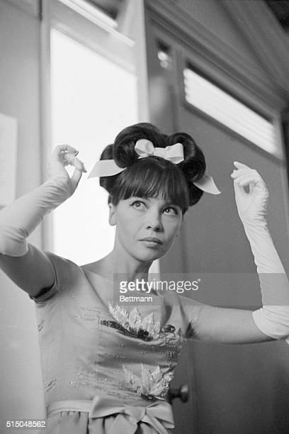 Actress Leslie Caron fixes her hairdo as she leaves dressing room for stage of 'ChalkGarden' Fashion Gala at Universal Studios March 31 Thirtysix...