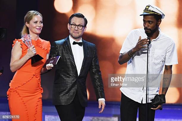 Actress Leslie Mann and actor Christian Slater look on as actor Keith Stanfield crashes the stage during the 22nd Annual Critics' Choice Awards at...
