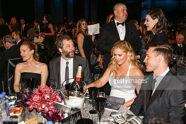 Actress Leslie Mann director Judd Apatow honoree Amy Schumer and designer Ben Hanisch attend the 21st Annual Critics' Choice Awards at Barker Hangar...