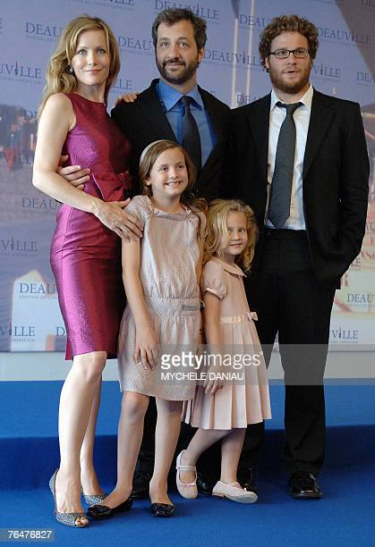 US actress Leslie Mann US film director Judd Apatow and Canadian actor Seth Rogen pose with actresses Iris and Maud during the photocall of Knocked...