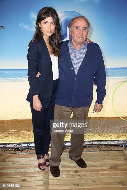Actress Leslie Medina and Actor Claude Brasseur attend the 'Camping 3' Paris Premiere at Gaumont Champs Elysees on June 23 2016 in Paris France