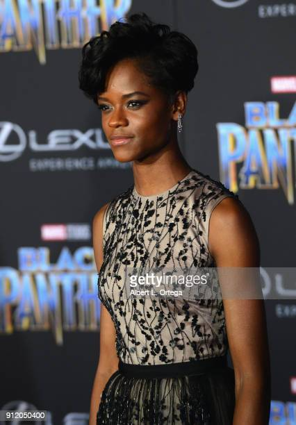 Actress Letitia Wright poses on the purple carpet for the Premiere Of Disney And Marvel's 'Black Panther' held at the Dolby Theatre on January 29...