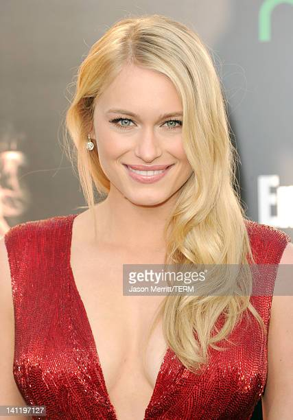 Actress Leven Rambin arrives at the premiere of Lionsgate's The Hunger Games at Nokia Theatre LA Live on March 12 2012 in Los Angeles California