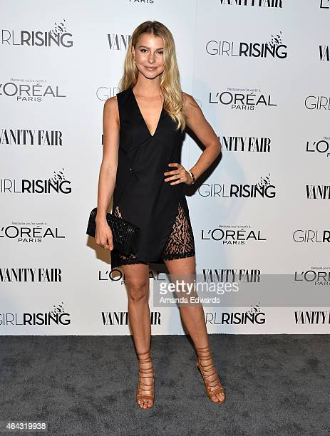 Actress Lexi Atkins arrives at the Vanity Fair and L'Oreal Paris Girl Rising benefit at 1 OAK on February 20 2015 in West Hollywood California
