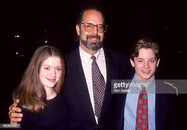 Actress Lexi Randall director John Avnet and actor Elijah Wood attend The War Beverly Hills Premiere on November 2 1994 at the Academy Theatre in...