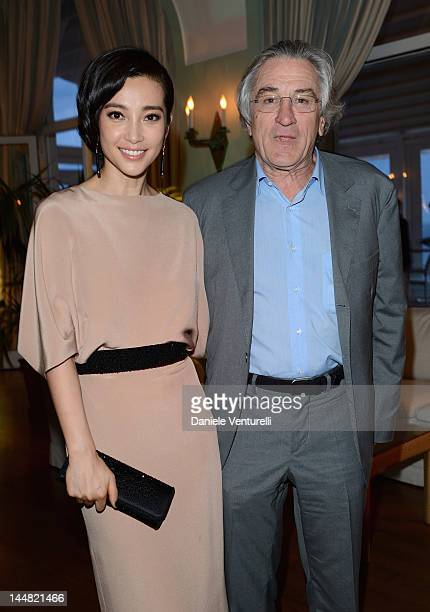 Actress Li Bingbing and avtor Robert De Niro attend the Vanity Fair and Gucci Party at Hotel Du Cap during 65th Annual Cannes Film Festival on May 19...