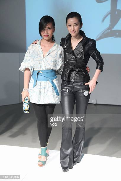 Actress Li Bingbing and photographer Chen Man attend the Photography Exhibition By Chen Man at Today Art Museum on April 23 2011 in Beijing China