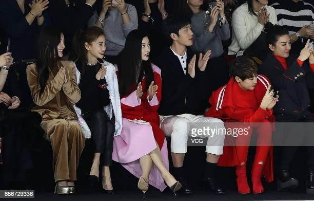 Actress Li Xiaolu actress Angelababy actress Fan Bingbing and actor Jing Boran watch the M77 'Too Cool For Boys' fashion show by Chinese actor Huang...