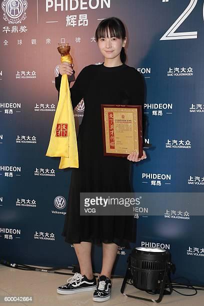 Actress Li Yuan poses during the 20th Huading Awards and China Film Satisfaction Survey Release Ceremony at Kowloon Bay International Trade...