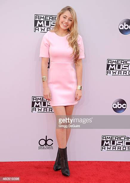 Actress Lia Marie Johnson arrives at the 2014 American Music Awards at Nokia Theatre LA Live on November 23 2014 in Los Angeles California