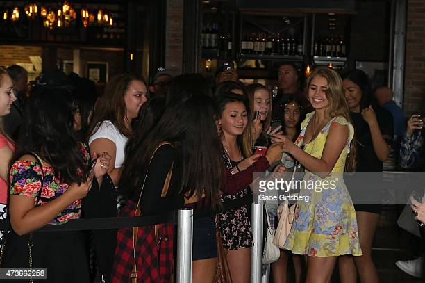 Actress Lia Marie Johnson greets fans at the Macy's iHeartRadio Rising Star instore performance at Fashion Show mall on May 16 2015 in Las Vegas...