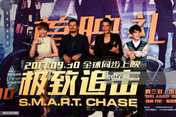 Actress Liang Jing actors Orlando Bloom Simon Yam and Wu Lei attend 'SMART Chase' premiere at Wanda Cinema on September 20 2017 in Beijing China