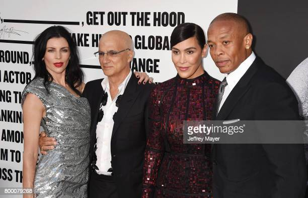 Actress Liberty Ross Chairman Interscope/Geffen/AM Records Jimmy Iovine Nicole Young and rapper/music producer/entrepreneur Dr Dre attend the...