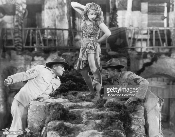 Actress Lili Damita and Victor McLaglen and Edmund Lowe in a scene from the movie The CockEyed World