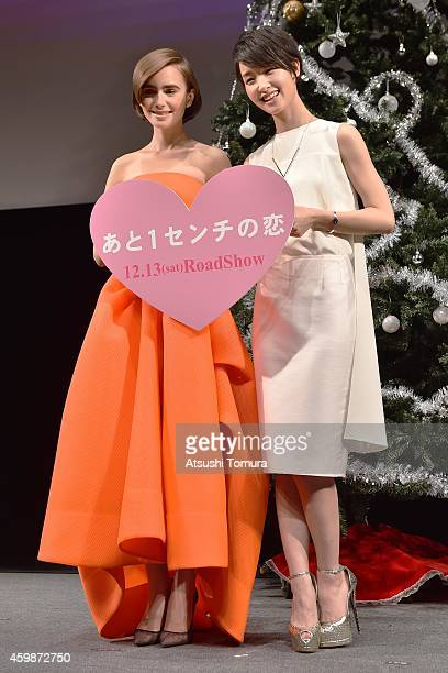 Actress Lily Collins and Actress Ayame Goriki attend the premiere of Love Rosie on December 3 2014 in Tokyo Japan