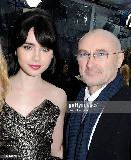 Actress Lily Collins and musician Phil Collins arrive at Relativity Media's 'Mirror Mirror' Los Angeles premiere at Grauman's Chinese Theatre on...