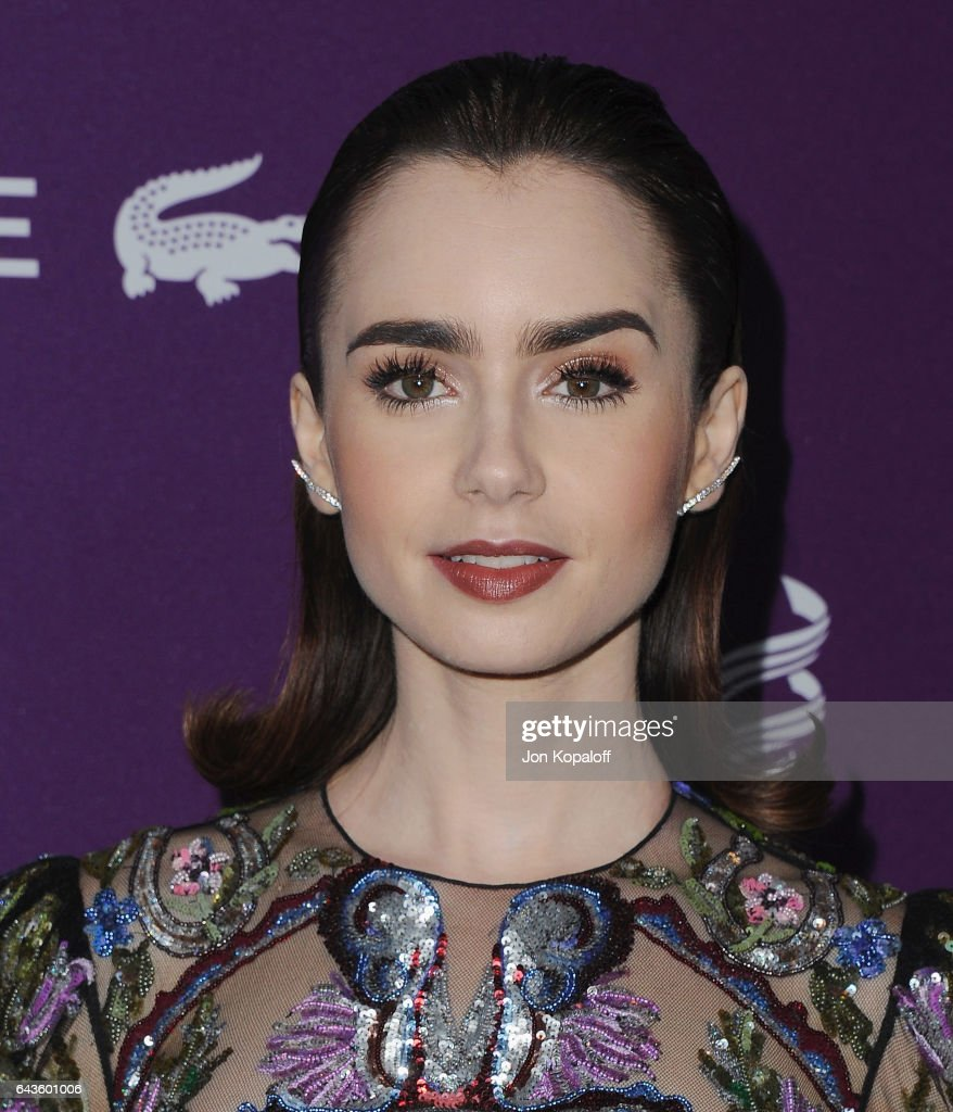 Actress Lily Collins arrives at the 19th CDGA (Costume Designers Guild Awards) at The Beverly Hilton Hotel on February 21, 2017 in Beverly Hills, California.