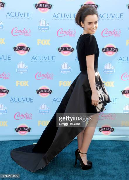 Actress Lily Collins arrives at the 2013 Teen Choice Awards at Gibson Amphitheatre on August 11 2013 in Universal City California