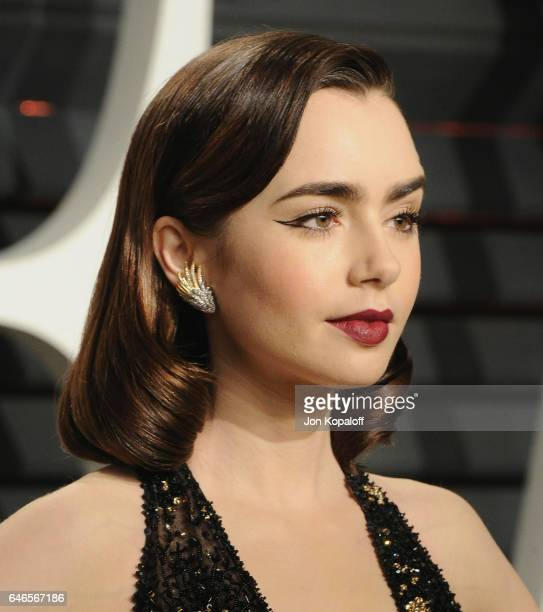 Actress Lily Collins Arrives At The 2017 Vanity Fair Oscar Party Hosted By Graydon Carter At
