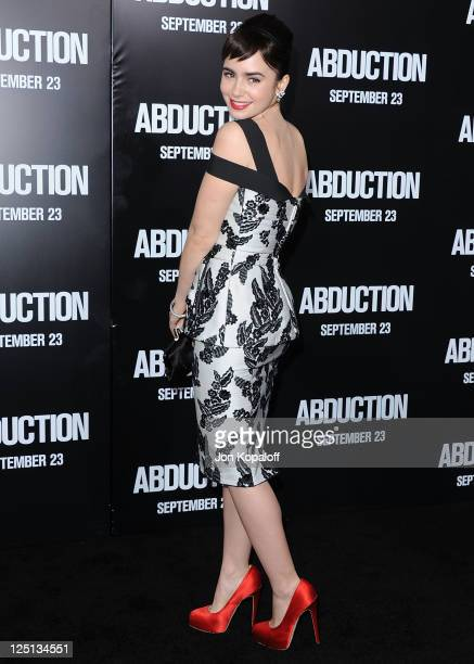 Actress Lily Collins arrives at the Los Angeles Premiere Abduction at Grauman's Chinese Theatre on September 15 2011 in Hollywood California