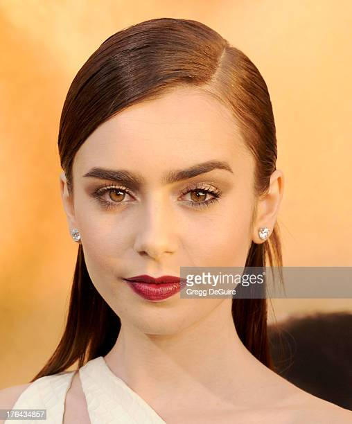 """Actress Lily Collins arrives at the Los Angeles premiere of """"The Mortal Instruments: City Of Bones"""" at ArcLight Cinemas Cinerama Dome on August 12,..."""