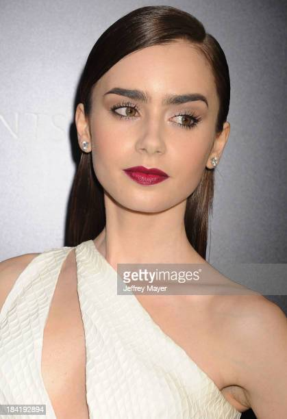 Actress Lily Collins arrives at the Los Angeles premiere of 'The Mortal Instruments City Of Bones' at ArcLight Cinemas Cinerama Dome on August 12...