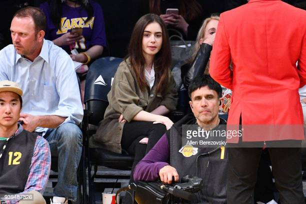 Actress Lily Collins attends a basketball game between the Los Angeles Lakers and the Dallas Mavericks at Staples Center on March 28 2018 in Los...