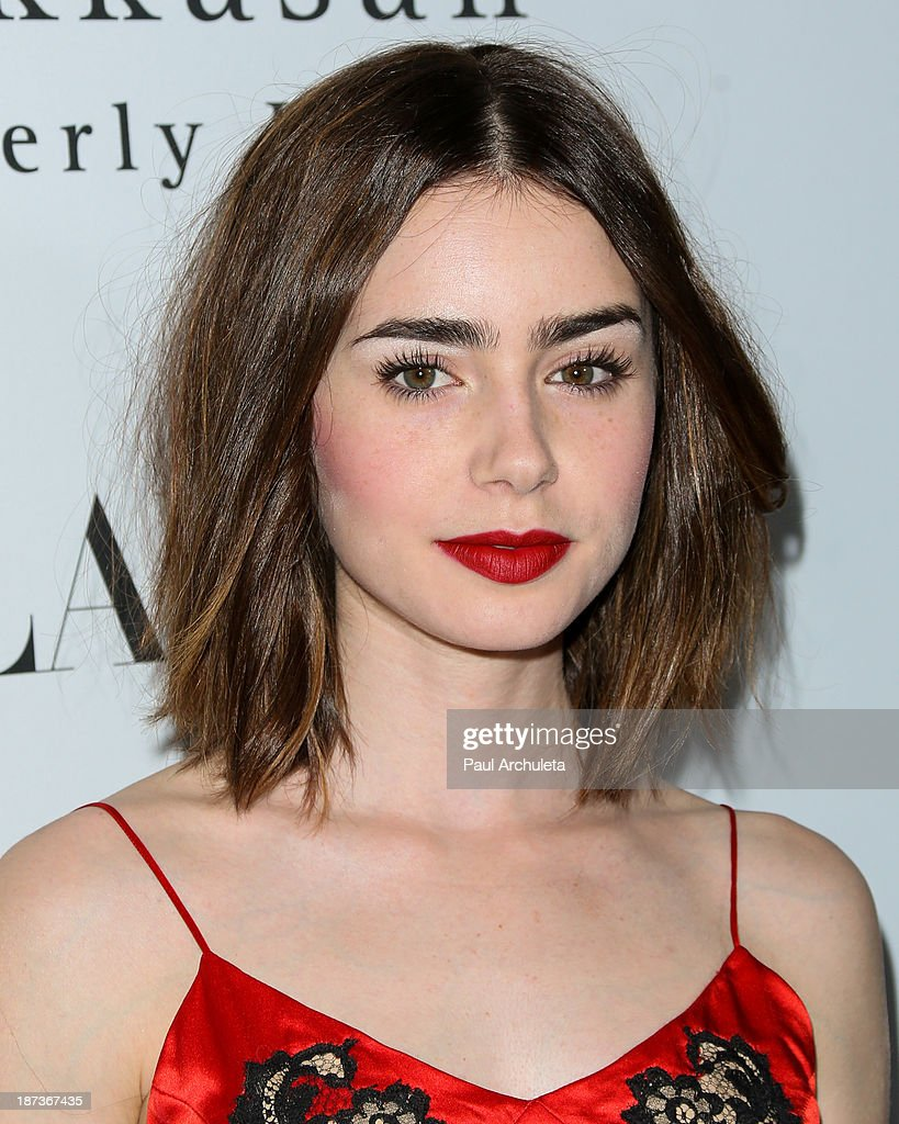 Actress Lily Collins attends Flaunt magazine En Garde! issue launch party on November 7, 2013 in Beverly Hills, California.