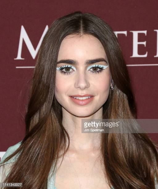 Actress Lily Collins attends the Les Miserables New York premiere at Times Center on April 08 2019 in New York City