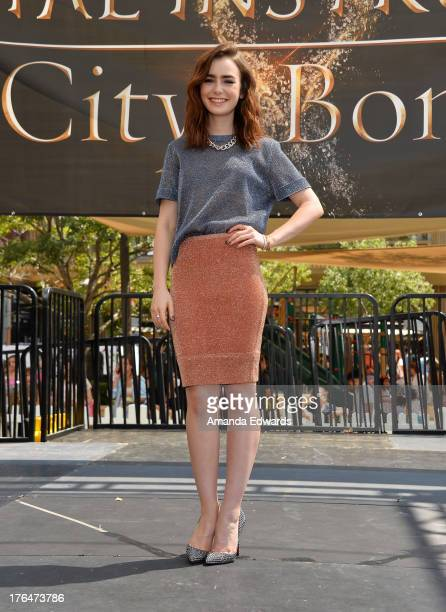 Actress Lily Collins attends 'The Mortal Instruments City Of Bones' meet and greet at The Americana at Brand on August 13 2013 in Glendale California