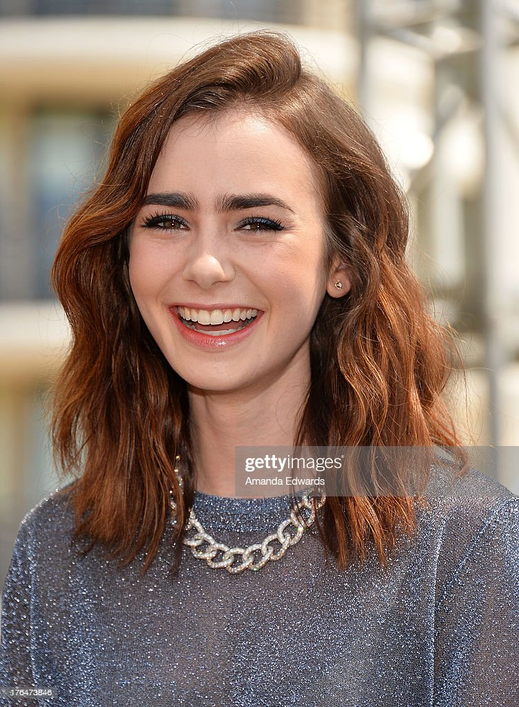 Actress Lily Collins attends 'The Mortal Instruments: City Of Bones' meet and greet at The Americana at Brand on August 13, 2013 in Glendale, California.