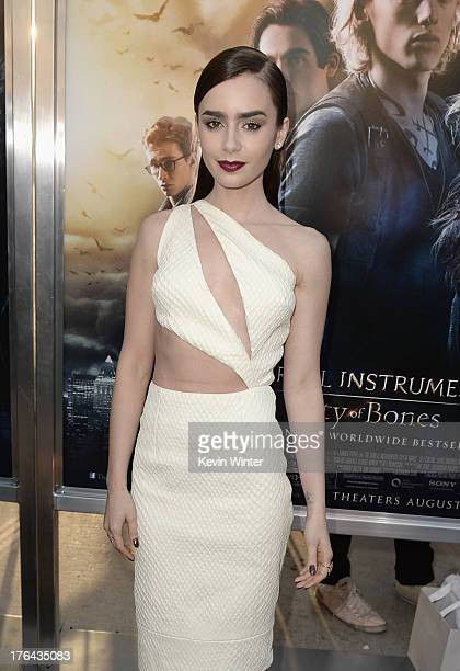 Actress Lily Collins attends the premiere of Screen Gems Constantin Films' The Mortal Instruments City of Bones at ArcLight Cinemas Cinerama Dome on...